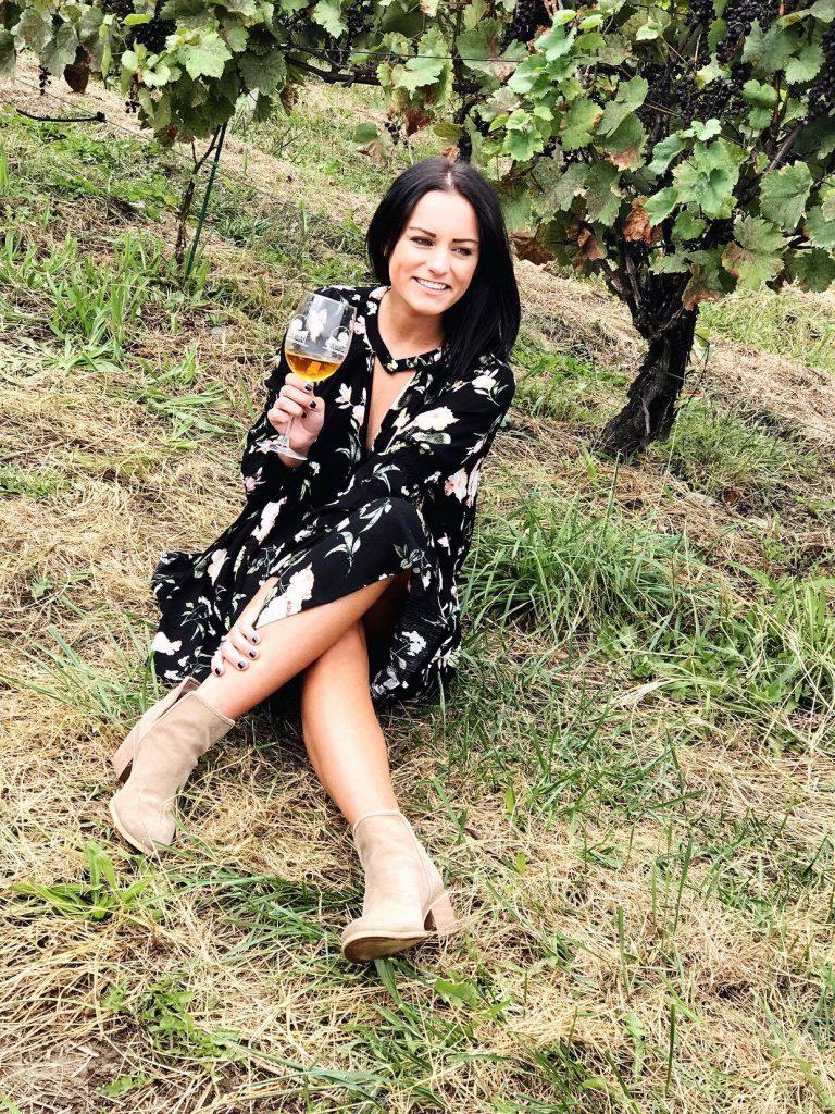 sitting down wine tasting wearing a black free people dupe dress