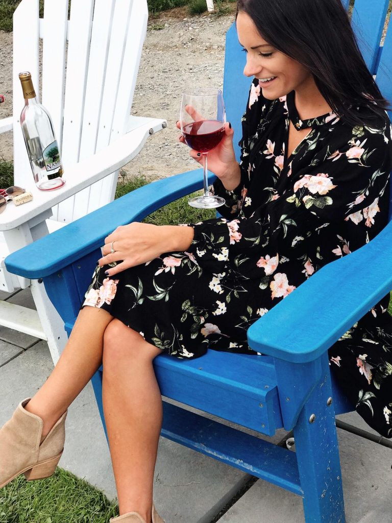 sitting down at a wine tasting wearing a black and pink flower dress from amazon