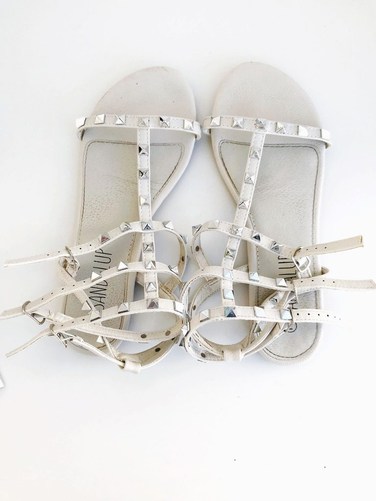 white studded sandals that look like designer inspired lookalikes from amazon