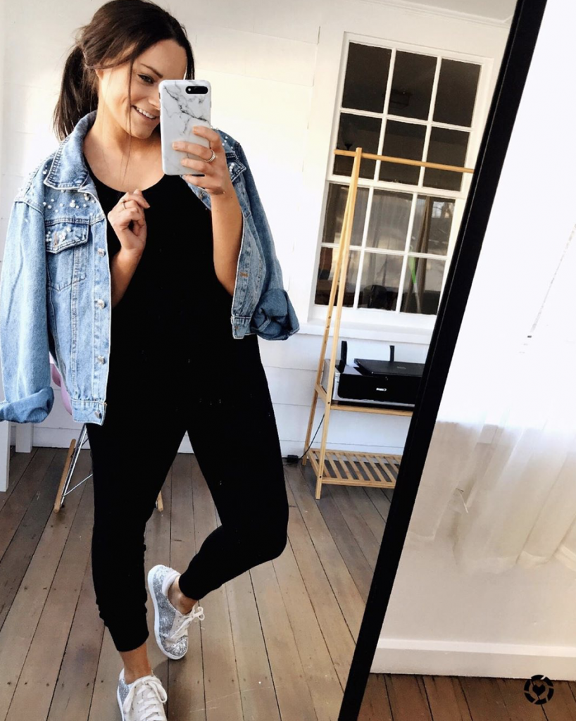black romper from American eagle with pearl jean jacket designer lookalike from amazon and sparkly gray designer lookalike sneakers