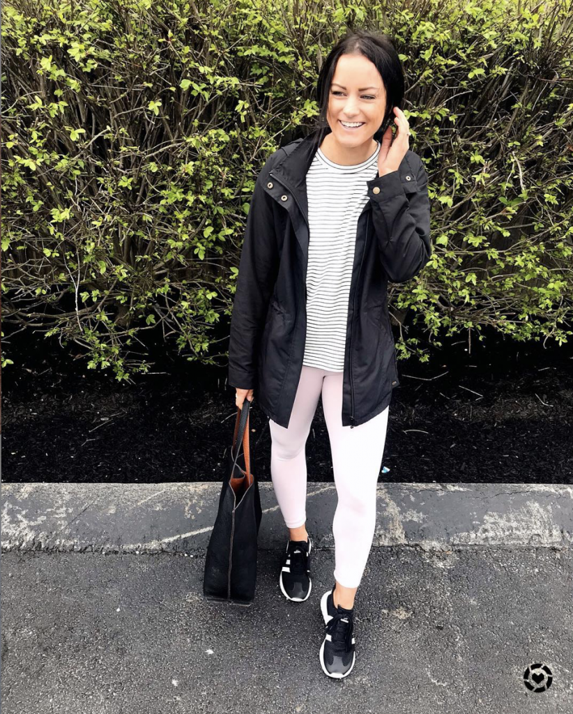 amazon athleisure outfits with black Adidas sneakers pink leggings from amazon and flattering black rain coat
