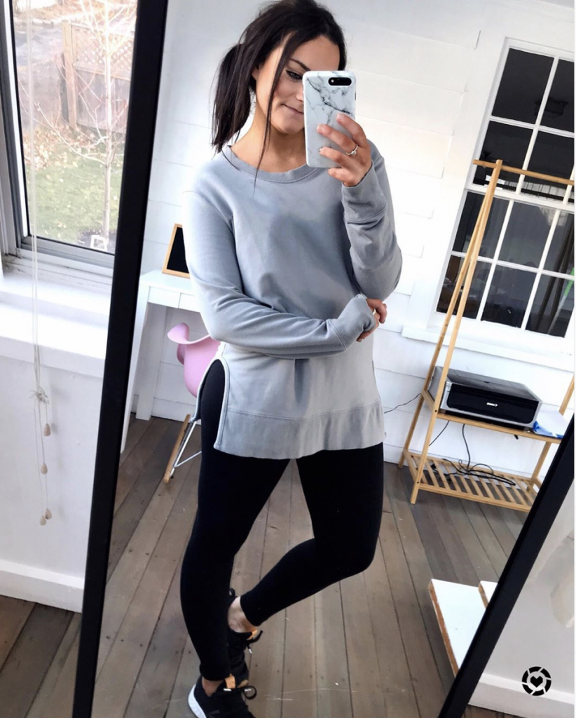 comfy athleisure outfit from amazon wearing casual black leggings and black sneakers