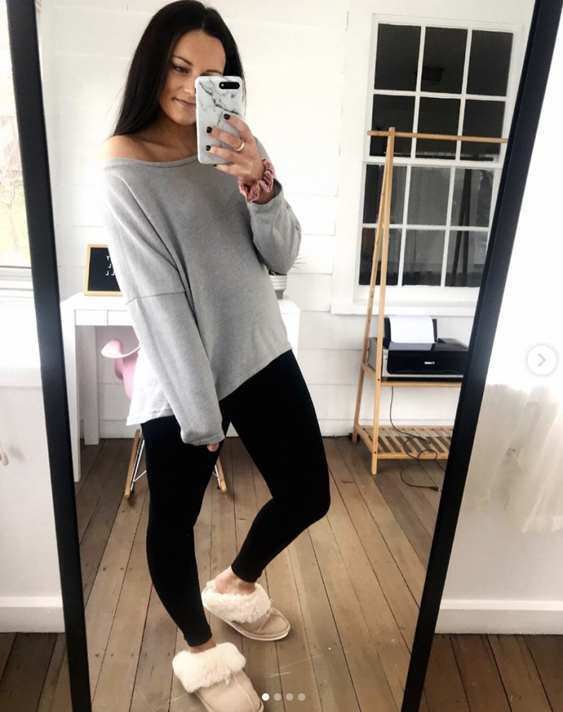 amazon loungewear outfit wearing tan ugg dupe slippers, oversized gray top and black leggings