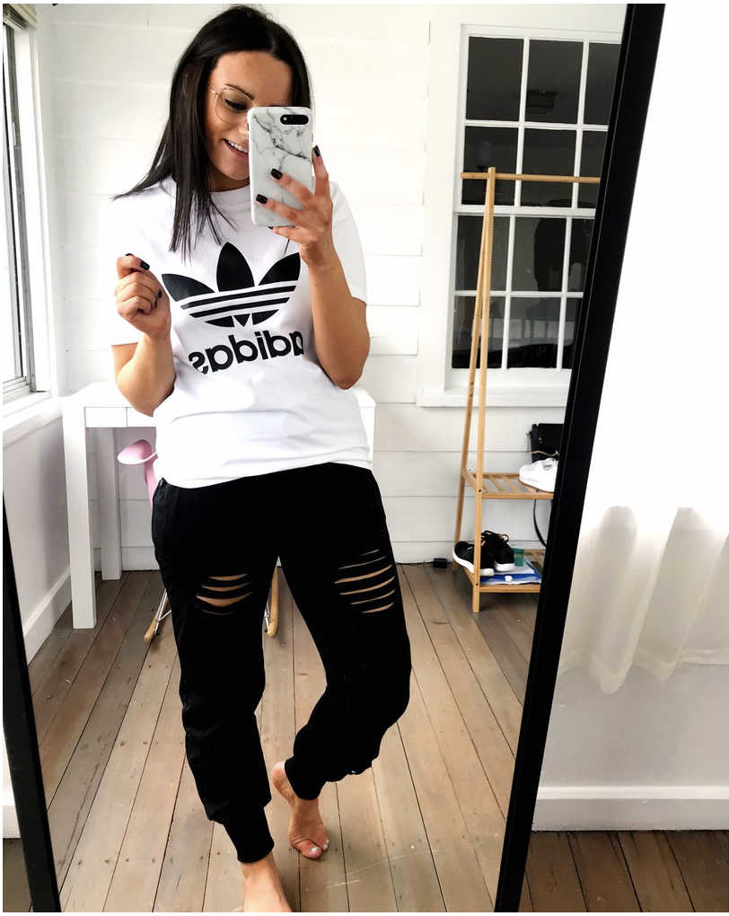 amazon loungewear outfit wearing white and black adidas tee shirt and ripped joggers