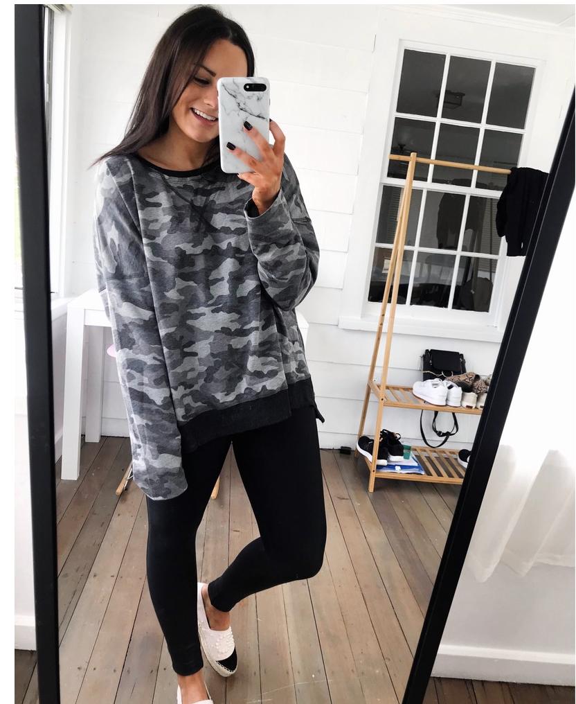 amazon loungewear outfit wearing black amazon leggings and camo amazon sweatshirt