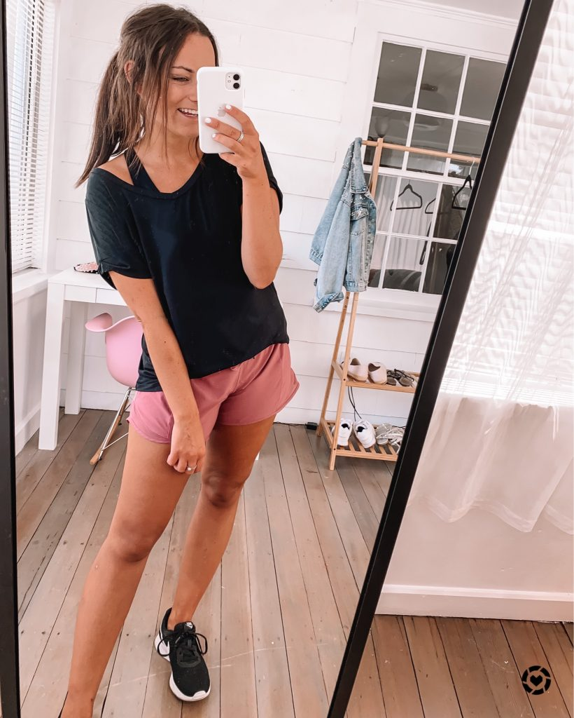 amazon prime pink workout outfit wearing black top and nike sneakers