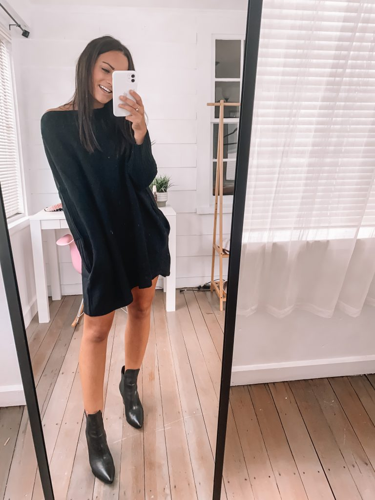 black sweater dress with pockets for fall with black booties