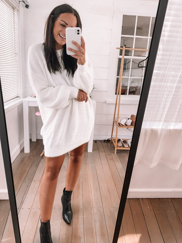 white sweater dress from amazon prime with black leather booties